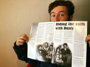 Dusty Rider checking out my interview in British Bluegrass News